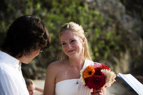 bride on beach in Mexico photo by Kate Harrison