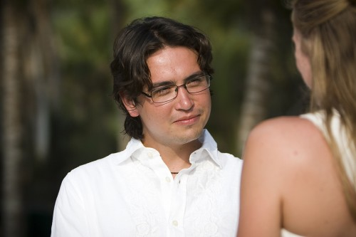 groom on beach photo by Kate Harrison