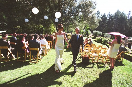 Small wedding ceremony and reception in the front gardens of a gorgeous Tudor estate in the hills above Napa Valley. Photo courtesy of Susan Adler Photography