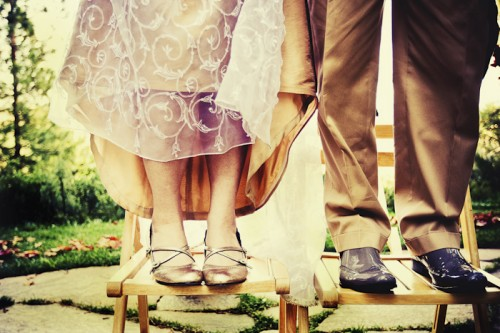 bride and groom standing on chairs outdoor diy wedding