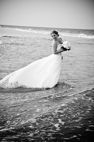 trash the dress in the ocean