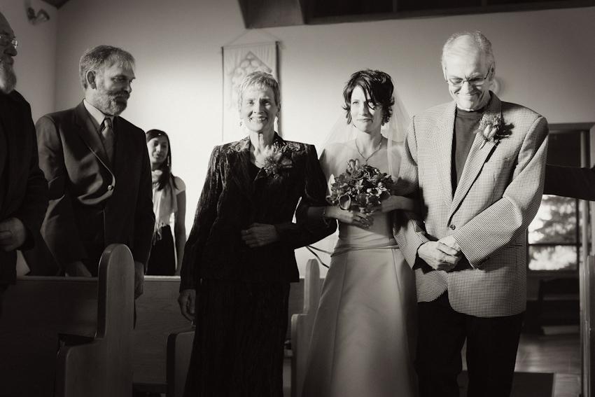 bride escorted down the aisle church wedding