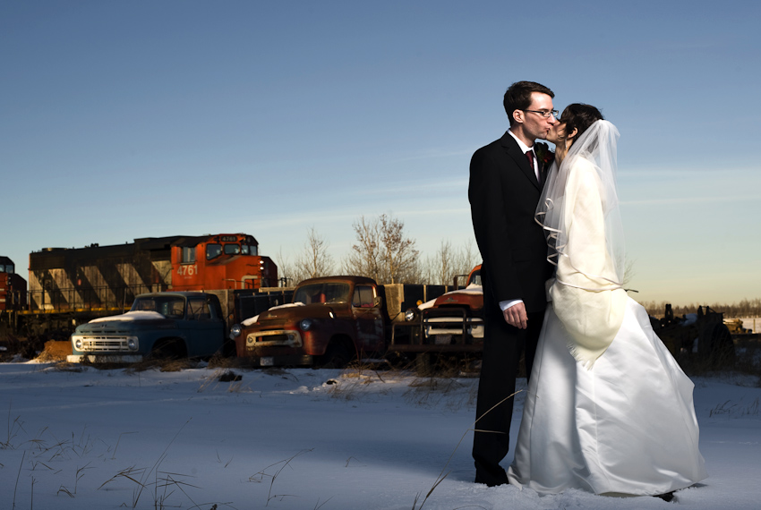 bride and groom in front of CN train