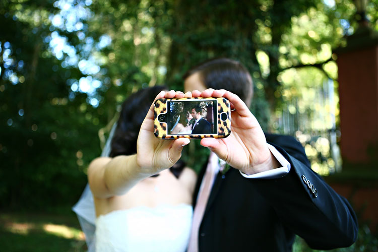 wedding couple with camera