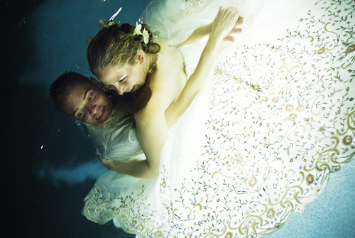 trash the dress in a swimming pool
