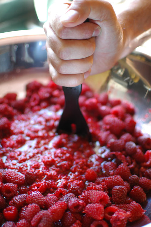 mashing raspberries