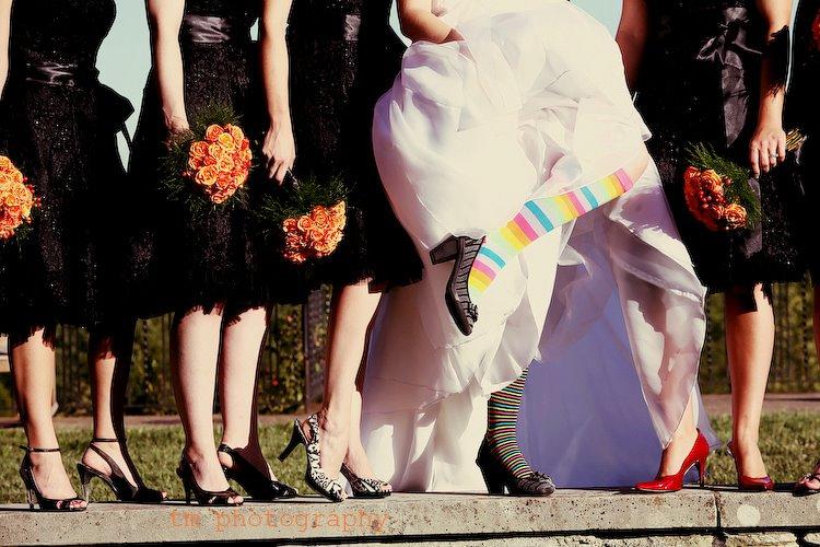 bride wearing striped socks - photo by Tine Hoffman