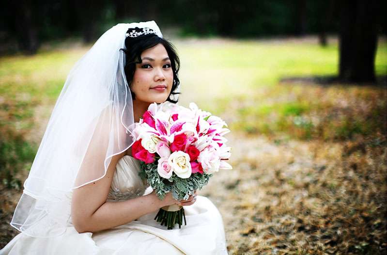 bride holding rose bouquet