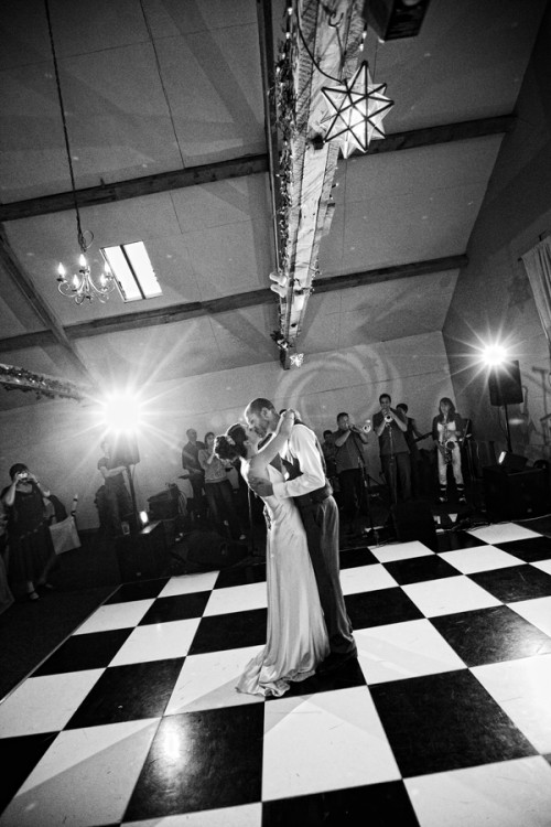bride and groom dancing in a barn