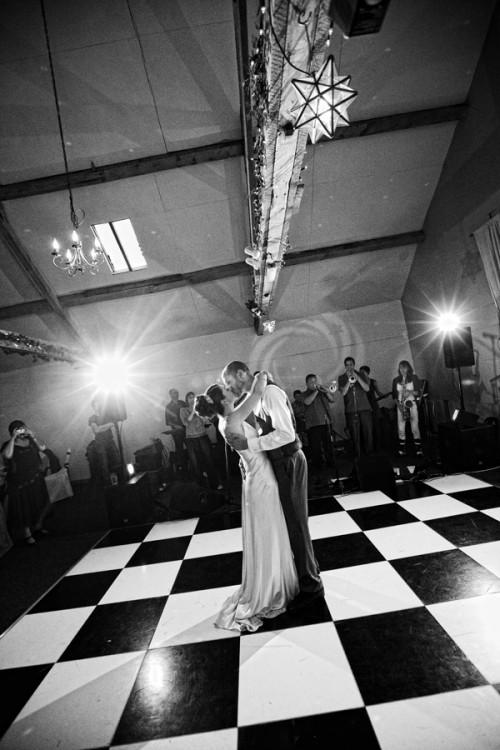 bride and groom dancing in a barn