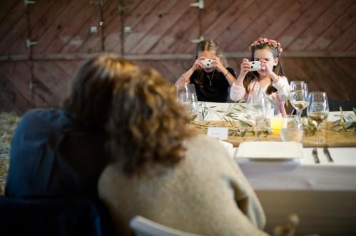 kids taking photos at wedding