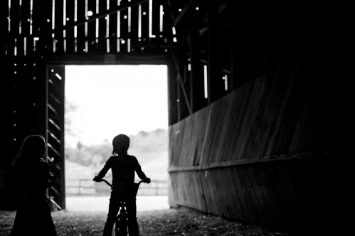 child in barn
