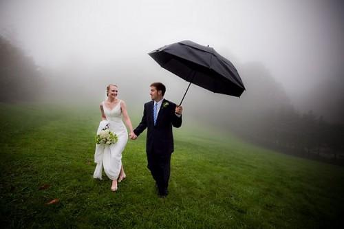 bride and groom in fog