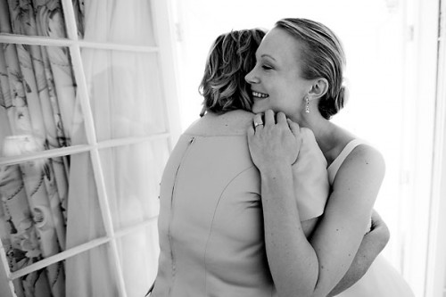 mother daughter wedding hug