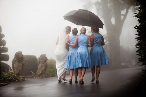 bridesmaids with umbrella