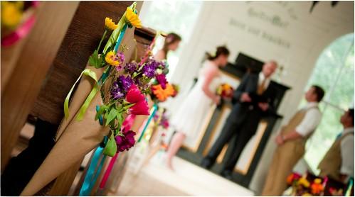 wedding flowers on pew