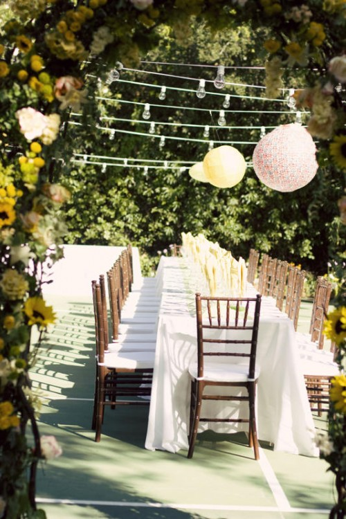 outdoor wedding with pom poms