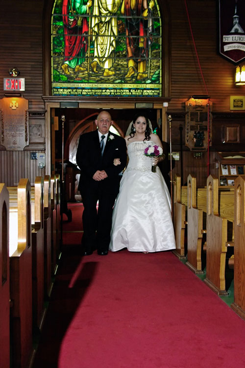 father walking down the aisle with bride