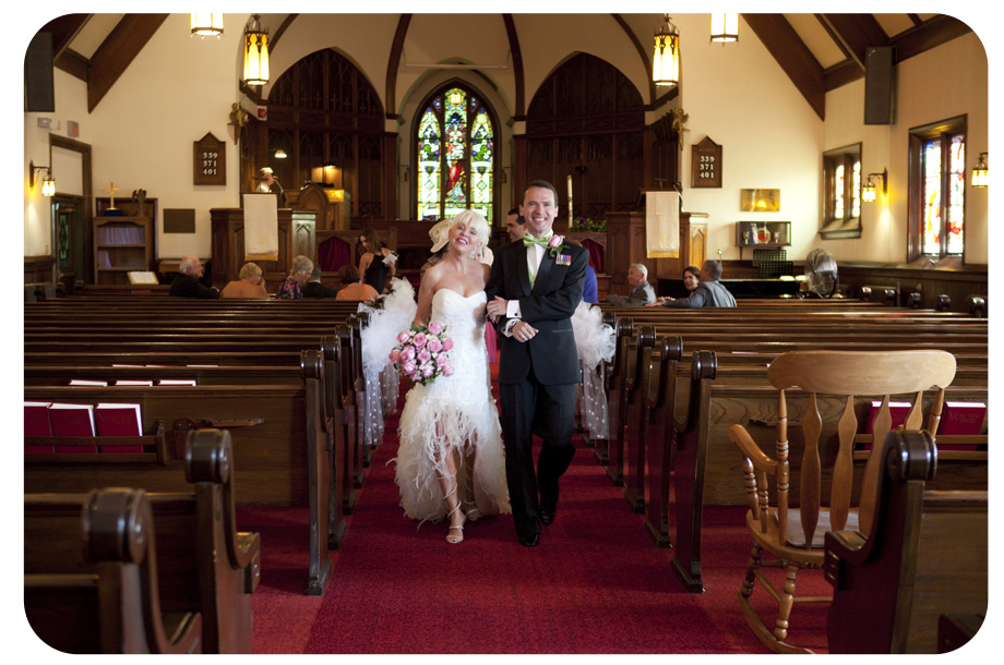 bride and groom walking down the aisle in church