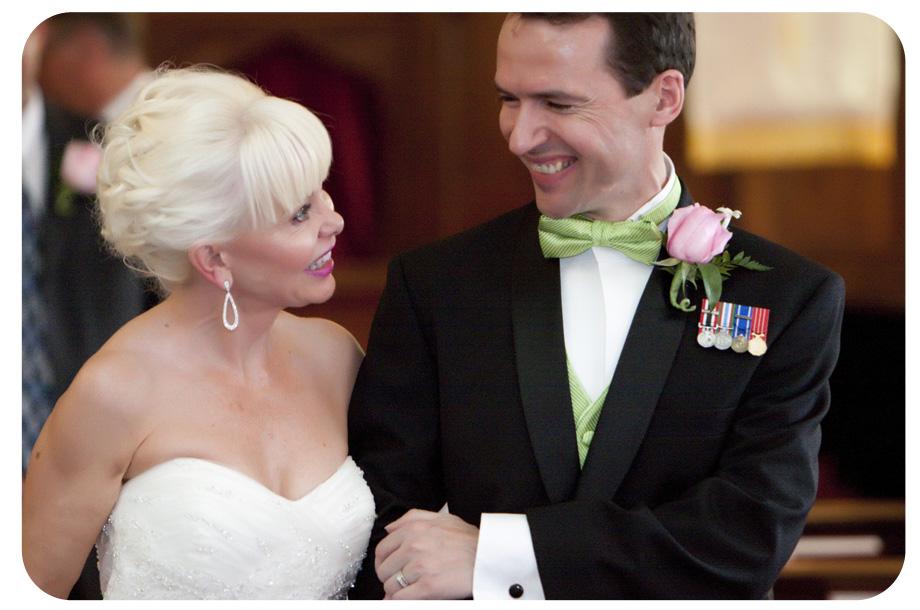 groom wearing green bowtie