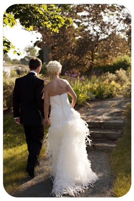 bride and groom on sidewalk