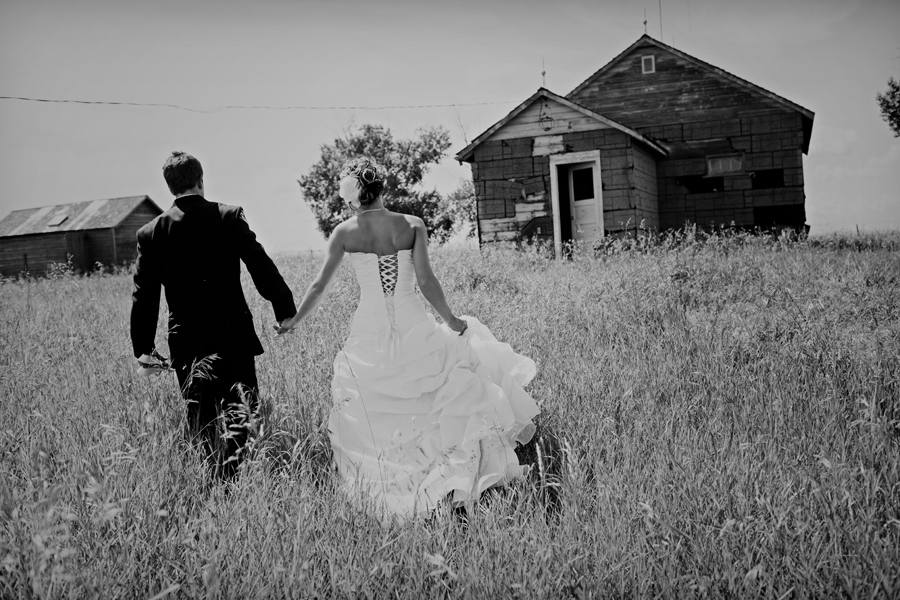 bride and groom in a farm field