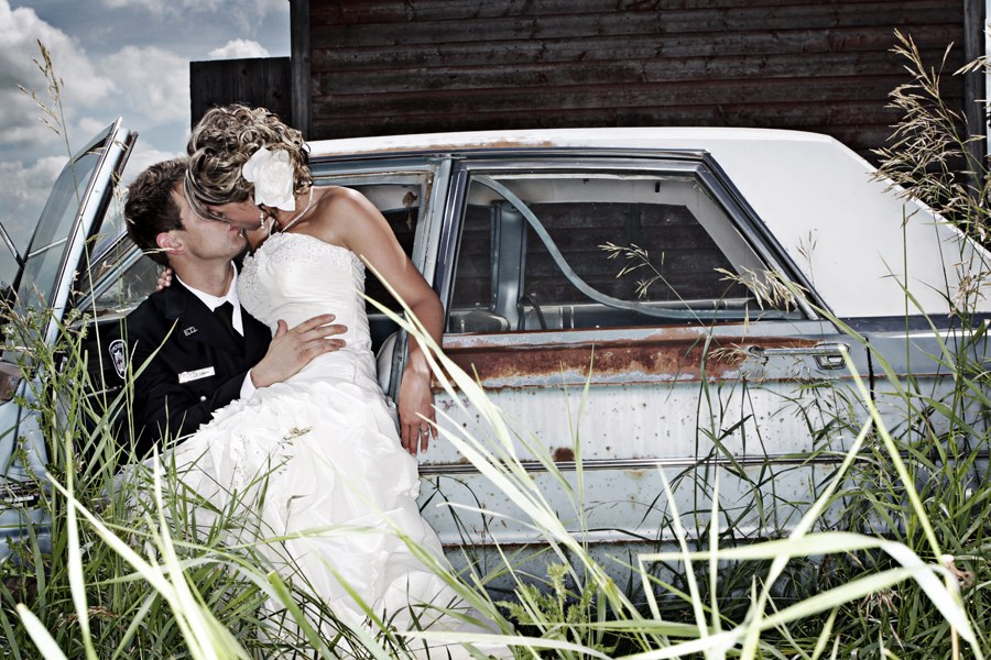 bride and groom in abandoned car