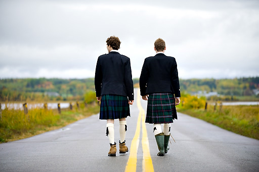 groom and best man wearing kilts