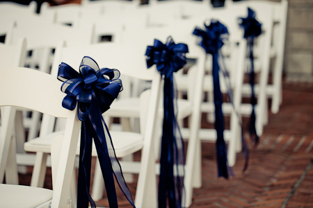 blue ribbon chair decor for wedding ceremony