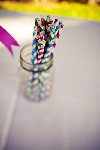 colorful striped straws in a mason jar
