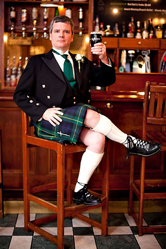 kilted groom in pub