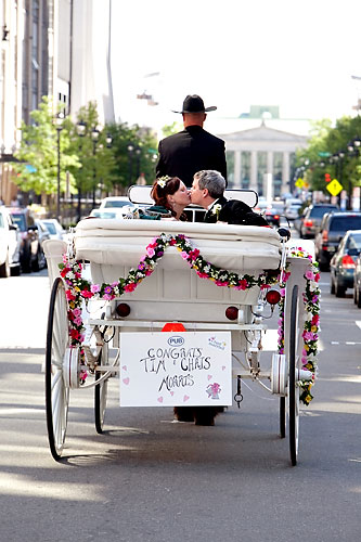 bride and groom in horse drawn carriage