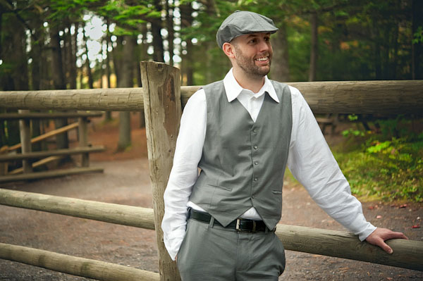 groom in grey vest and cap