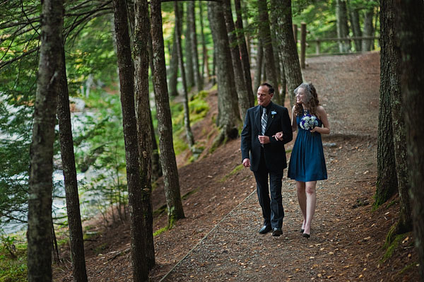bride and father walking in the woods