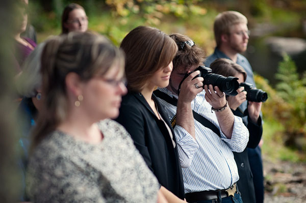 guests photographing wedding