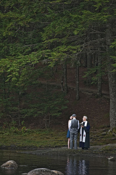 Bride and groom exchanging vows by the river