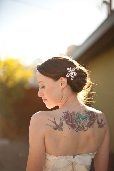 bride with back tattoo