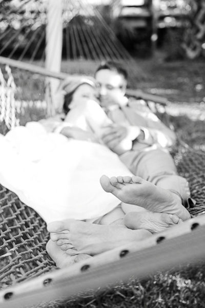 bride and groom in a hammock
