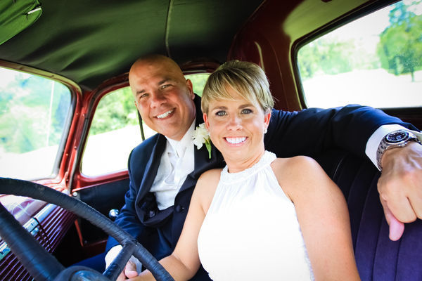 bride and groom in vintage pick-up truck