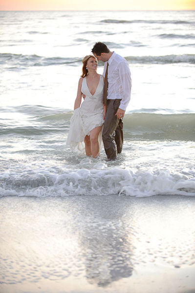 bride and groom in the surf
