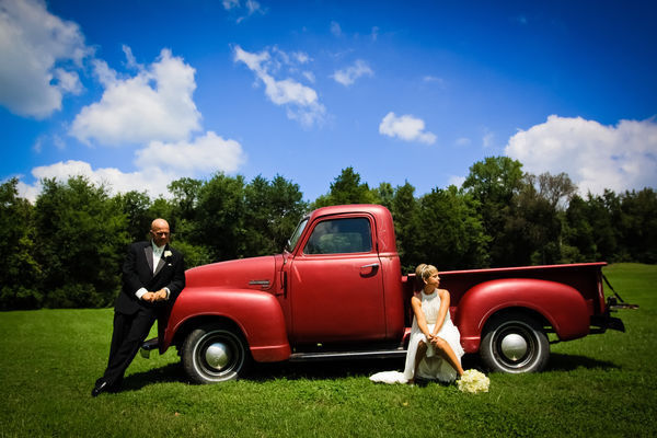 bride and groom with vintage red pick-up truck
