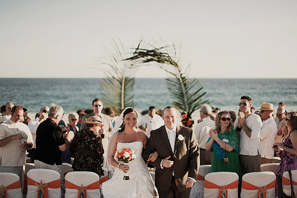bride and groom recessional on the beach