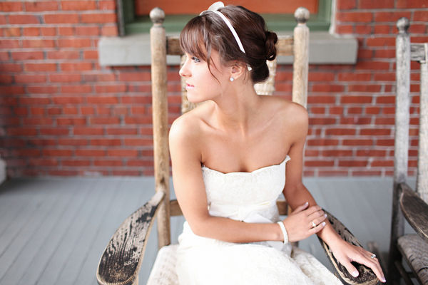 bride sitting in antique wooden chair