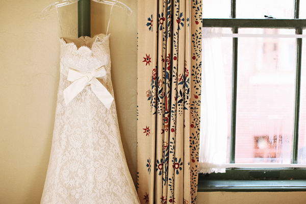 wedding dress hanging by the window