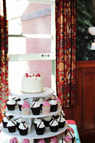 small wedding cake and cupcakes