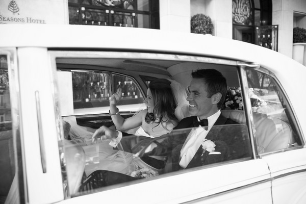 black and white bride and groom in limo
