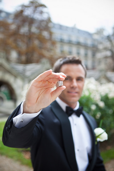 groom with wedding bands