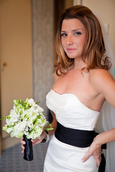 bride in wedding dress with black sash