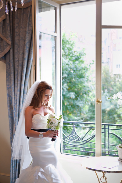 bride posing by window