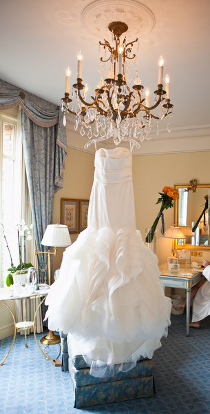 wedding dress hanging on chandelier